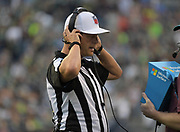 Aug 25, 2017; Seattle, WA, USA; referee Craig Wrolstad (4) reviews a play on a Microsoft Surface table during a NFL football game between the Seattle Seahawks and the Kansas City Chiefs at CenturyLink Field.