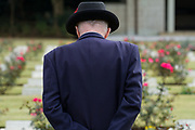 An older man looks at war graves during the Remembrance Sunday ceremony at the Hodogaya, Commonwealth War Graves Cemetery in Hodogaya, Yokohama, Kanagawa, Japan. Sunday November 12th 2017. The Hodagaya Cemetery holds the remains of more than 1500 servicemen and women, from the Commonwealth but also from Holland and the United States, who died as prisoners of war or during the Allied occupation of Japan. Each year officials from the British and Commonwealth embassies, the British Legion and the British Chamber of Commerce honour the dead at a ceremony in this beautiful cemetery.