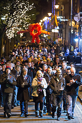 """© Licensed to London News Pictures . 1/12/2012 . Manchester , UK . Hundreds mark World AIDS Day with a candlelit procession through Manchester City Centre 's """" Gay Village """" . Campaigners are urging people to take regular HIV tests . It's estimated as many as 1 in 4 HIV positive people do not know they are infected with the virus . Photo credit : Joel Goodman/LNP"""