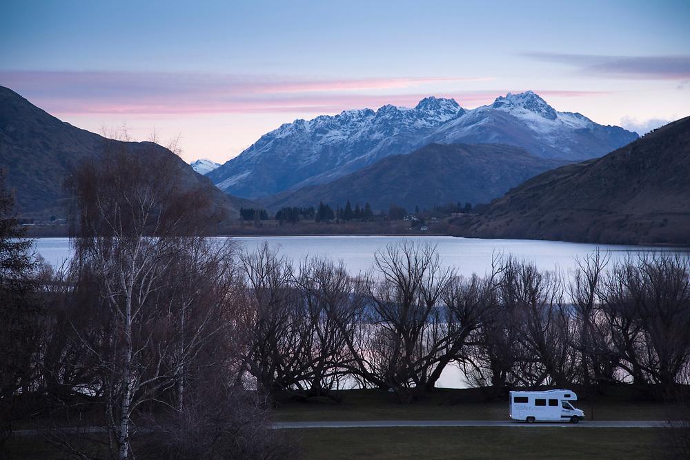 Campervan parked beside Lake Hayes, Queenstown at dusk.