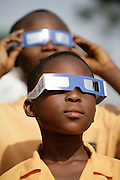 Children watching the solar eclipse using special shades in Accra, Ghana on March 29, 2006.