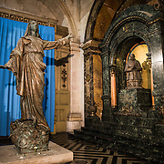 At left is a statue being renovated that was originally on the roof of the Metropolitan Cathedral of Santiago (Catedral Metropolitana de Santiago) in the heart of Santiago, Chile, facing Plaza de Armas. The original cathedral was constructed during the period 1748 to 1800 (with subsequent alterations) of a neoclassical design.
