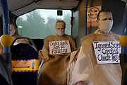 "Extinction Rebellion Penitents on the bus into Truro to protest for climate change at Truro Cathedral in Cornwall at 11am on the 28th of August 2020 in Truro, United Kingdom. Based on the medieval idea of repenting transgressions against your community by wearing sackcloth and ashes whilst bearing your ""sins"" around your neck. The Penitents performed in total silence in this highly visual ceremony. Starting at the Truro Park and Ride they travelled into Truro and walked in procession through the town before carrying out the ceremony. These protests are highlighting that the government is not doing enough to avoid catastrophic climate change and to demand the government take radical action to save the planet.<br /> <br /> Extinction Rebellion is a climate change group started in 2018 and has gained a huge following of people committed to peaceful protests. These protests are highlighting that the government is not doing enough to avoid catastrophic climate change and to demand the government take radical action to save the planet."