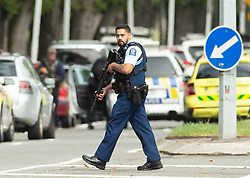 March 15, 2019 - Christchurch, Canterbury, New Zealand - Armed police following a shooting resulting in multiple fatalities and injuries at the Masjid Al Noor Mosque, Deans Avenue, Christchurch, New Zealand. At least 49 people were killed and 20 seriously injured in mass shootings at two mosques in the New Zealand city of Christchurch. 48 people, including young children with gunshot wounds, were taken to hospital. Three people were arrested in connection with the shootings. (Credit Image: © Martin Hunter/SNPA via ZUMA Wire)