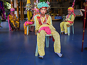 "04 APRIL 2015 - CHIANG MAI, CHIANG MAI, THAILAND: Boys being ordained at the Poi Sang Long Festival wait for the ordination ceremony to start. The Poi Sang Long Festival (also called Poy Sang Long) is an ordination ceremony for Tai (also and commonly called Shan, though they prefer Tai) boys in the Shan State of Myanmar (Burma) and in Shan communities in western Thailand. Most Tai boys go into the monastery as novice monks at some point between the ages of seven and fourteen. This year seven boys were ordained at the Poi Sang Long ceremony at Wat Pa Pao in Chiang Mai. Poy Song Long is Tai (Shan) for ""Festival of the Jewel (or Crystal) Sons.      PHOTO BY JACK KURTZ"