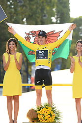 Tour de France 2018 winner Great Britain's Geraint Thomas holds the Welsh flag as he celebrates his overall leader yellow jersey on the podium after the 21st and last stage of the 105th edition of the Tour de France cycling race between Houilles and Paris Champs-Elysees, in Paris, France, on July 29, 2018. Photo by Eliot Blondet/ABACAPRESS.COM