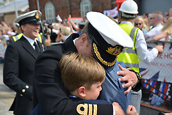 HMS St AlbansÕ commanding officer, Commander Richard Hutchings is welcomed home by sons James, 13, and Freddie 11, as the frigate arrives back at Portsmouth Naval Base following a nine-month deployment to the Middle East.