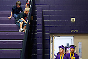 Young audience members get the first look at Columbia High School graduates before a commencement ceremony on June 1, 2012 in the Burbank school's gym.