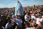 Gypsy Roma and Gitan pilgrims carry Saint Sara to the seashore during the Gypsy Pilgrimmage of Saintes Maries de la Mer  <br /><br />Europe, France, Camargue, Saintes Maries de la Mer, Gypsy Pilgrimmage 'Pelerinage des Gitans aux Saintes Maries de la Mer'. Gypsies from all over the world come to celebrate their patron Saint Sara who is carried by them from the church to the sea-shore. May 24th and 25th every year