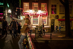 August 25, 2017 - Amsterdam, Netherlands - After the quiet early evening hours, Amsterdam's streets and squares get again very busy at night. At the back of the Dam square, the whole area of town called Red Light District is always invaded by large groups of tourists walking in the streets and looking at the windows with the girls. Nearby small restaurants and cafes are full of people. (Credit Image: © Velar Grant via ZUMA Wire)