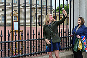 Members of the public take photographs of the official notice of the birth of a baby boy to the Duke and Duchess of Sussex outside Buckingham Palace on May 6, 2019 in London,England, United Kingdom. Meghan, Duchess of Sussex gave birth to a baby boy weighing 7lbs 3oz at 05:26 BST.