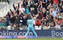 England's Chris Woakes celebrates the catch of Pakistan's Imam-ul-Haq (not pictured) with the crowd during the ICC Cricket World Cup group stage match at Trent Bridge, Nottingham.