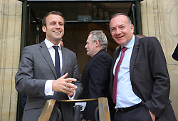 French Minister of the Economy, Industry and the Digital Sector Emmanuel Macron and French Employer Federaton MEDEF President Pierre Gattaz wait to welcome South African President Jacob Zuma at Cercle de l'Union Interalliee, in Paris, France on July 11, 2016. President Zuma is on two-day state visit to France. Photo by Somer/ABACAPRESS.COM