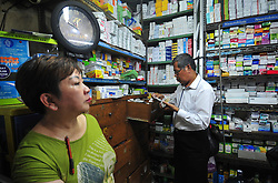 JAKARTA, Sept. 7, 2016 (Xinhua) -- A plainclothes police officer examines medicines during a raid to discover fake and expired medicines of various types inside a drugstore in Jakarta, Indonesia, Sept. 7, 2016. (Xinhua/Zulkarnain).****Authorized by ytfs* (Credit Image: © Zulkarnain/Xinhua via ZUMA Wire)