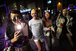 © Licensed to London News Pictures . 27/10/2018. Manchester, UK. A reveller dressed up as Britney Spears on a night out with friends , outside the Printworks in Manchester City Centre , on the weekend before Halloween . Photo credit: Joel Goodman/LNP