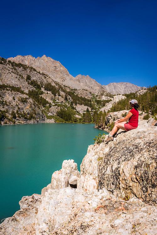 Hiker on the shore of Big Pine Lake #3, John Muir Wilderness, Sierra Nevada Mountains, California USA