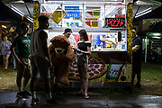 WASHINGTON, USA - August 19: A group of teens hang out next to a pizza truck at the Montgomery County Agricultural Fair in Gaithersburg, Md., USA on August 19, 2017.