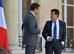 French Minister of the Economy, Industry and the Digital Sector Emmanuel Macron and Prime Minister Manuel Valls after the last cabinet meeting before the government's annual summer vacation at the Elysee Palace, in Paris, France on July 30, 2015. Photo by Christian Liewig/ABACAPRESS.COM