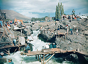 CS00378-09. Indians fishing in Downes channel at Celilo Falls, September 1953. This is a good example of the tremendous amount of amateur photography that was taken at Celilo. Lafie Foster, the photographer of The Dalles Daily Chronicle, said that in the years immediately before 1957, more pictures were taken at Celilo than anywere else in the state. This 35mm Kodachrome slide was made by a linolium installer from Portland, Constantine Zimmerman. Ultimately, the interesting composition of the photograph earned it a place in the book Wild Beauty.