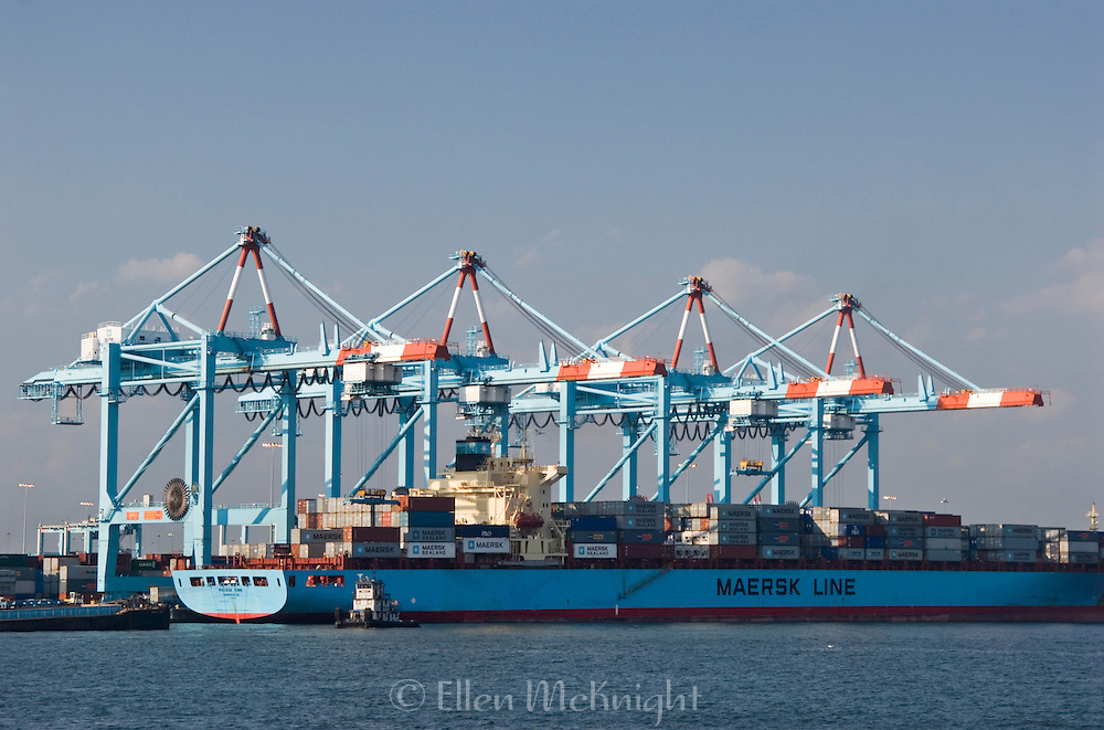 Loading Containers onto Maersk Sealand Container Ship in Port Elizabeth New Jersey in the Newark Harbor. The A.P. Moller-Maersk Group is based in Denmark and is the largest container shipping company in the world.