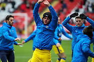 AFC Wimbledon defender Nesta Guinness-Walker (18) warming up prior to kick off during the EFL Sky Bet League 1 match between Charlton Athletic and AFC Wimbledon at The Valley, London, England on 12 December 2020.