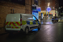 © Licensed to London News Pictures. 14/12/2020. London, UK. A police forensic van parked on a side road near to the crime scene on St Anns Road. Police were called at approximately 19:15GMT on Sunday, 13 December to reports of a stabbing in St Anns Road, Harrow. Officers and London Ambulance Service attended. <br /> A man – believed aged in his 20s – was found suffering stab injuries; despite the efforts of the emergency services he was pronounced dead at the scene. Two further males – both believed aged in their late teens – also suffered stab injuries. Photo credit: Peter Manning/LNP