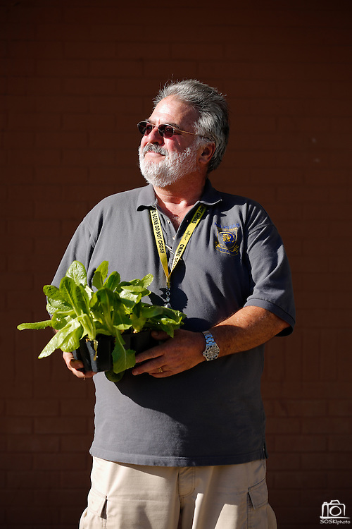 Milpitas High School biology and forensic science teacher Gordon Sanford poses for a portrait outside the American Heart Association Teaching Garden at Milpitas High School in Milpitas, California, on October 8, 2013. (Stan Olszewski/SOSKIphoto)