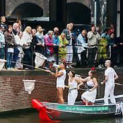 NLD/Amsterdam/20100807 - Boten tijdens de Canal Parade 2010 door de Amsterdamse grachten. De jaarlijkse boottocht sluit traditiegetrouw de Gay Pride af. Thema van de botenparade was dit jaar Celebrate, Aidsfonds collecteerd voor geld