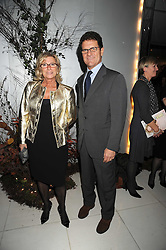 England football manager FABIO CAPELLO and his wife LAURA at a reception before the launch of the English National Ballet Christmas season launch of The Nutcracker held at the St,Martins Lane Hotel, London on 5th December 2008.