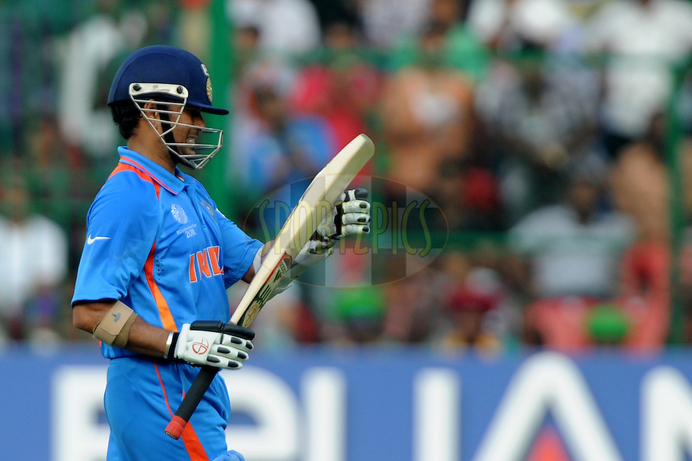 Sachin Tendulkar of India walks back after getting out during the ICC Cricket World Cup match between India and England held at the M Chinnaswamy Stadium in Bengaluru, Bangalore, Karnataka, India on the 27th February 2011..Photo by Pal Pillai/BCCI/SPORTZPICS