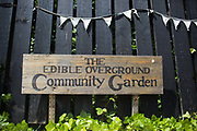 A sign at Brondesbury Park Station in the Energy Garden 22nd May 2016,London,United Kingdom. At the meeting are local residents, Repowering London representatives and the station manager. Repowering London and their Energy Garden project in the making. Energy Gardens is a pan-London community garden project where reclaimed land alongside over ground train stations and track are cultivated by local community groups. Up 50 gardens are projected with the rail network being the connection grid. The project is a collaboration between Repowering London, local community groups and station managers working for TFL.