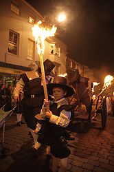 © under license to London News Pictures.  05/11/2010. Torchlit processions through parade through Lewes, East Sussex on bonfire night upholding thier traditional celebrations. This event not only marks the date of the uncovering of the Gunpowder Plot in 1605, but also commemorates the memory of the seventeen Protestant martyrs burnt at the stake for their faith during the Marian Persecutions. The celebrations are the largest and most famous Bonfire Night celebrations in the country.