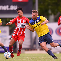BRISBANE, AUSTRALIA - MARCH 4: Zelfy Nazary of Olympic and Anthony Grant of Thunder compete for the ball during the NPL Queensland Senior Mens Round 5 match between Olympic FC and SWQ Thunder at Goodwin Park on March 4, 2017 in Brisbane, Australia. (Photo by Patrick Kearney/Olympic FC)