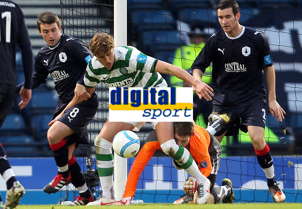 Football - Scottish League Cup Semi-Final - Celtic vs. Falkirk<br />  <br /> <br /> Celtic's Thomas Rogne competes with Falkirk's Micheal McGovern in a goal mouth scramble during the Celtic vs. Falkirk League Cup Semi Final match at Hampden Park , Glasgow on January 29th 2012<br /> <br /> <br /> Ian MacNicol/Colorsport