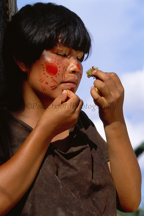 Campa Indian painting her face with Achiote<br />
