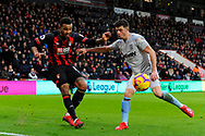 Joshua King (17) of AFC Bournemouth crosses the ball while being challenged by Aaron Cresswell during the Premier League match between Bournemouth and West Ham United at the Vitality Stadium, Bournemouth, England on 19 January 2019.
