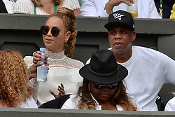 © Licensed to London News Pictures. 09/07/2016.   BEYONCÉ and JAY Z watch tennis on the centre court on the thirteenth day of the WIMBLEDON Lawn Tennis Championships. London, UK. Photo credit: Ray Tang/LNP