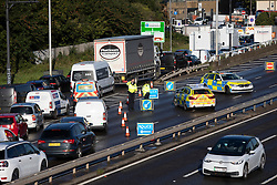 © Licensed to London News Pictures. 03/10/2021. London, UK. Police use a roadblock to divert traffic on the A102 Blackwall Tunnel approach after activists from Insulate Britain blocked part of the tunnel earlier this morning. Insulate Britain have successfully blocked various roads around the capital over a number of weeks, resulting in a court injunction banning them from going near the M25 motorway.  Photo credit: George Cracknell Wright/LNP