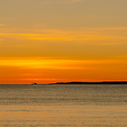 I was very fortunate to have a clear sky and a beautiful sunrise for our last day on Cape Ann, MA.  There is fishing boat nicely silhouetted in the distance as it heads out to sea.