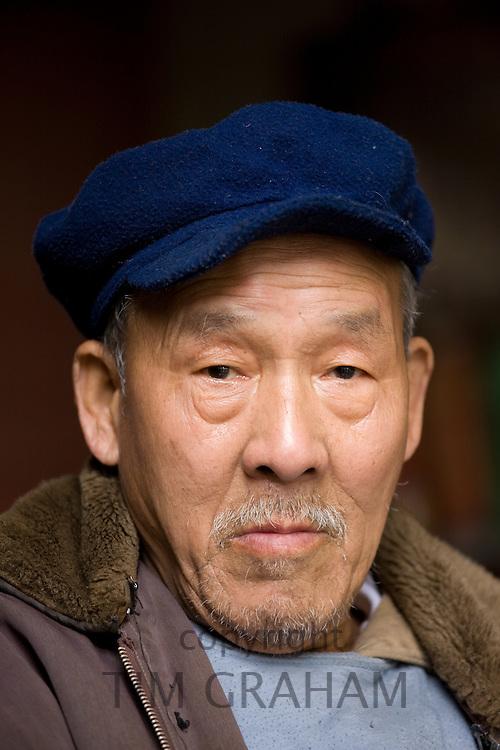 Chinese man in Fuli Old Town, Xingping, China
