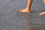Child's feet in water in the fountain on Place de la Bourse. Bordeaux city, Aquitaine, Gironde, France
