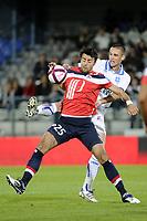 FOOTBALL - FRENCH CHAMPIONSHIP 2011/2012 - L1 - AJ AUXERRE v LILLE OSC  - 15/10/2011 - PHOTO JEAN MARIE HERVIO / DPPI - MARKO BASA (LOSC) / ANTHONY LE TALLEC (AJA)