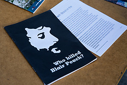 Southall, UK. 27th April 2019. A booklet on a stall at a rally by members of the local community and supporters outside Southall Town Hall to honour the memories of Gurdip Singh Chaggar and Blair Peach on the 40th anniversary of their deaths. Gurdip Singh Chaggar, a young Asian boy, was the victim of a racially motivated attack whilst Blair Peach, a teacher, was killed by the Metropolitan Police's Special Patrol Group during a peaceful march against a National Front demonstration.