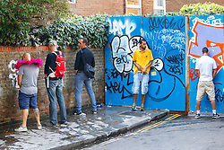 © Licensed to London News Pictures. 29/08/2016. London, UK. Revellers urinate in public as they enjoy the second day of Notting Hill Carnival in west London, Monday 29 August 2016. Photo credit: Tolga Akmen/LNP