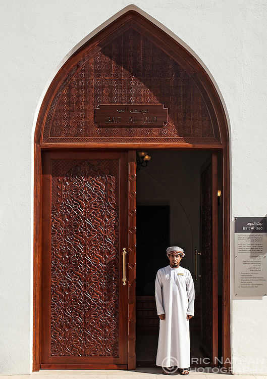 Omani man standing in a doorway in the Bait Al Zubair museum complex in Old Muscat, part of the capital of the Sultanate of Oman.