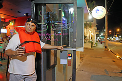 Mike Powers stands in the doorway of the Salty Angler Bar wearing a life vest on Duval Street in Key West, FL, USA., Friday, September 8, 2017. He is one of the residents of Key West who refused to evacuate as Hurricane Irma approaches the Florida Keys. Photo by Charles Trainor Jr./Miami Herald/TNS/ABACAPRESS.COM