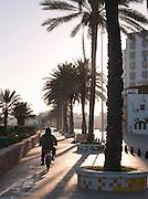 Man riding a motocycle through the Market in Mahdia, Tunisia