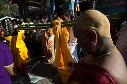 © Licensed to London News Pictures. 24/01/2016 Ipoh, Malaysia. A baby is carried in a sling suspended on bamboos arrive at Kallumalai Murugan Temple in Ipoh, Malaysia, during the Thaipusam Festival, Sunday, Jan. 24, 2016. Photo credit : Sang Tan/LNP