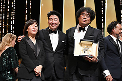 """Lee Jung-Eun, Kang-Ho Song and Director Bong Joon-Ho, winner of the Palme d'Or award for """"Parasite"""" pose during the 72nd annual Cannes Film Festival on May 25, 2019 in Cannes, France.<br /> Photo by David Niviere/ABACAPRESS.COM"""