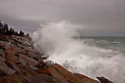This is a long way up and more to come. Waves from a Nor' Easter explode up the rocks below the Seagull restaurant at Pamaquid Point Lighthouse.
